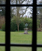 Garden sundial viewed from a window in Avebury Manor, Avebury, Wiltshire, England.