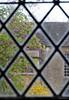 Through a diamond-paned window