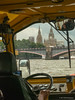 Big Ben and the Houses of Parliament visible past Lambeth Bridge, looking over the driver's shoulder.