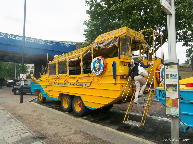 A World War II Duck (called DUKW by the military), modified for use as a tour bus and tour boat. The GIs landing at Normandy didn't have a roof, or windows, or rear-mounted stairs. Or seats, come to that.