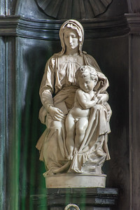 The white marble sculpture of Madonna and Child by Michelangelo
