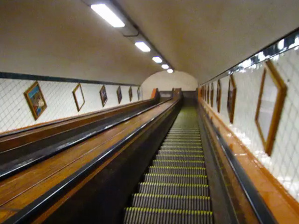 Going down the wooden escalators into the pedestrian/bike tunnel under the River Scheldt in Antwerp.