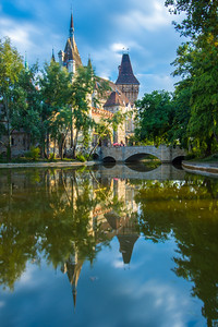 Vajdahunyad Castle.reflected in the water.