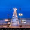 Eastern Europe - Bulgaria - България - Burgas - Bourgas - Бургас - Second-largest city & seaside resort on Bulgarian Black Sea Coast - Jetty with street lamps on sandy beach at Dusk - Twilight - Blue hour