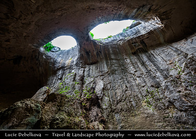Eastern Europe - Bulgaria - България - Geological Park Iskar-Panega - Prohodna Cave - Пещера Проходна - Spectacular karst cave located in Iskar Gorge, known for two eye-like holes in its ceiling, known as Oknata - The windows or Eyes of God formation - Prohodna cave is 262 metres (860 ft) long, which makes it the longest cave passage in Bulgaria - Cave has two entrances which lie opposite one another and the cave owes its name to this fact, which literally means Thoroughfare Cave or Passage Cave