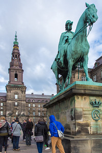 One of the kings of Denmark in front of Christiansborg Palace