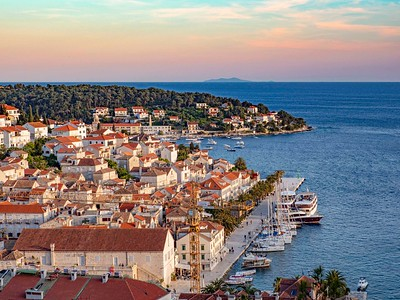 Hvar Island harbor viewed from the hillside fortress at sunset