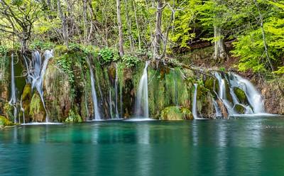 Smaller falls and azure water below
