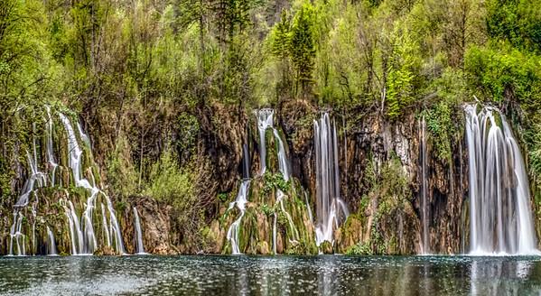 Multiple falls cascading into a lake