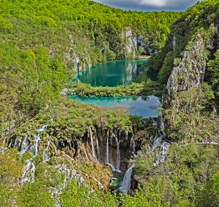 Plitvice Lakes National Park: a series of lakes connected by waterfalls, gushing water and wooden walkways                  aterways