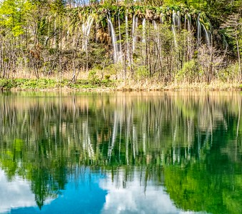 A more idyllic collection of falls reflected in a nearby lake