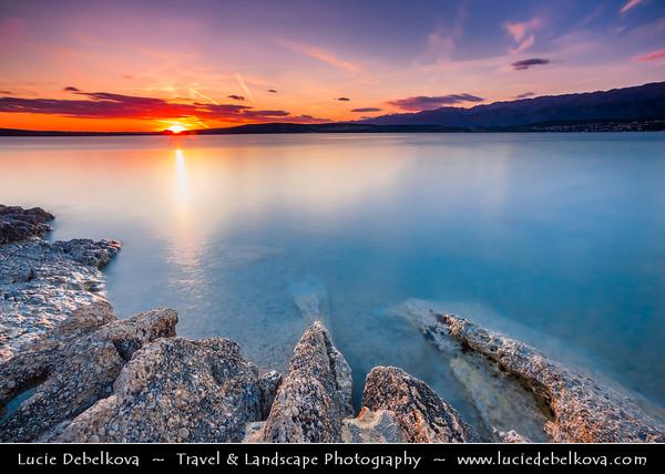 Europe - Croatia - Hrvatska - Dalmatia - Novigrad - Pittoresque town with ancient castle on shores of the Novigradsko More - Beautiful sunset on the beach