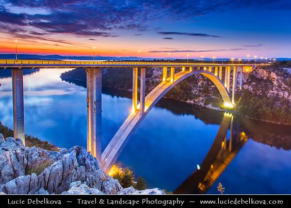 Europe - Croatia - Hrvatska - Dalmatia - Krka Bridge - 391 metres (1,283 ft) long concrete arch bridge spanning Krka River at height of 65 metres (213 ft) between Skradin & Šibenik interchanges at Dusk - Twilight - Blue Hour - Night - Evening - Sunset