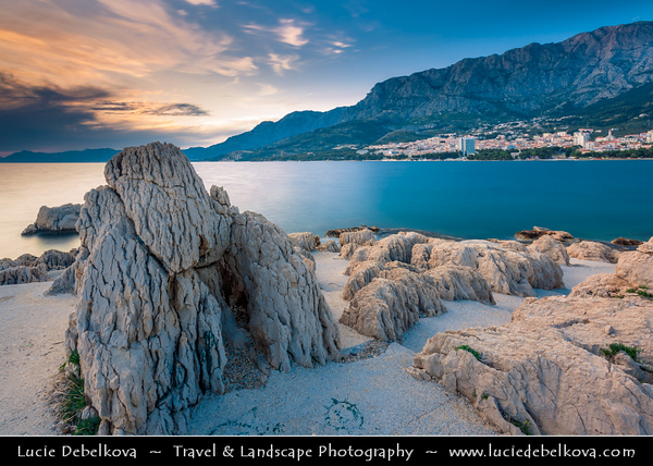 Europe - Croatia - Hrvatska - Central Dalmatia - Adriatic Coast - Makarska Rivijera - Makarska - Main beach resort built around a deep sheltered bay & backed by the dramatic rocky heights of Mount Biokovo 1762 m (5,770ft) and impressive Biokovo mountain range - Sunset