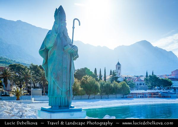 Europe - Croatia - Hrvatska - Central Dalmatia - Adriatic Coast - Makarska Rivijera - Baška Voda - Nikolina beach with statue of Saint Nicholas the traveller - Sv. Nikola Putnik