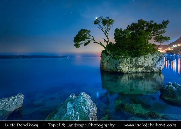 Europe - Croatia - Hrvatska - Central Dalmatia - Adriatic Coast - Makarska Rivijera - Brela Island - Kamen Brela - Brela Stone - Small rock island on the Punta Rata beach - Night
