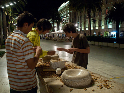 Split, waterfront, eating nuts