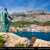Europe - Croatia - Hrvatska - Central Dalmatia - Adriatic Coast - Makarska Rivijera - Makarska - Main beach resort built around a deep sheltered bay & backed by the dramatic rocky heights of Mount Biokovo 1762 m (5,770ft) and impressive Biokovo mountain range - Old town and harbour from St. Peter - Sv. Petar statue with key to Makarska in his hand