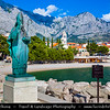 Europe - Croatia - Hrvatska - Central Dalmatia - Adriatic Coast - Makarska Rivijera - Baška Voda - Nikolina beach with statue of Saint Nicholas the traveller - Sv. Nikola Putnik
