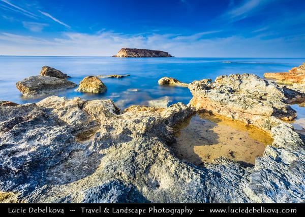 Europe - Cyprus - Κύπρος - Kýpros - Third largest island in Mediterranean Sea - West Coast - Region of Paphos - Πάφος - Pafos - Baf - Agios Georgios Pegeia Bay - Rocky beach with view towards Yeronissos Island - Yeronisos - Geronisos - Yeroniso Adası