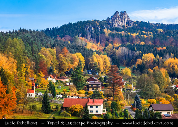 Europe - Czech Republic - Czechia - Bohemian Paradise - Český ráj - Protected Area & first nature reserve - UNESCO Geopark - Scenic area with bizarre rock formations - Maloskalsko region - Malá Skála - Suché skály - Sušky - Kantorovy varhany - Rock crest of solid sandstone sticks out above forest, resembling organ or dragon`s back within Vranov Ridge during fall with warm autumn colors