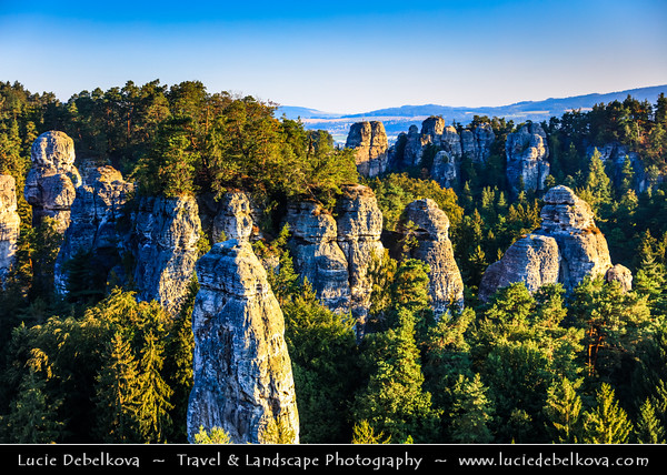 "Europe - Czech Republic - Bohemia - Bohemian Paradise - Český ráj - Protected Area &  first nature reserve - UNESCO Geopark - Scenic area with bizarre rock formations - Hruboskalsko Rock Town - One of the best-known rock formations areas with impressive towers reaching up to 55 m and steep canyons - Vyhlídka na Kapelu - Lookout point with view of a group of rocks called ""Kapela"" (the Band) and a solitary rock tower called ""Kapelník"" (Bandleader)"