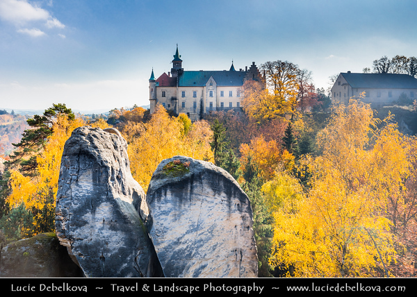 Europe - Czech Republic - Czechia - Bohemian Paradise - Český ráj - Protected Area & first nature reserve - UNESCO Geopark - Scenic area with bizarre rock formations - Zámek Hrubá Skála - Hrubá Skála Castle - Renaissance chateau and Iconic landmark situated on steep sandstone cliff during fall with warm autumn colors
