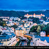 Europe - Czech Republic - Czechia - Karlovy Vary - Carlsbad - Karlsbad - Spa town on confluence of rivers Ohře & Teplá, named after Charles IV, Holy Roman Emperor & King of Bohemia, who founded city in 1370 - Historically famous for its hot springs (13 main springs, about 300 smaller springs) - Cityscape panorama of historic part with Thermal Spring Colonnade - Hot Spring Colonnade