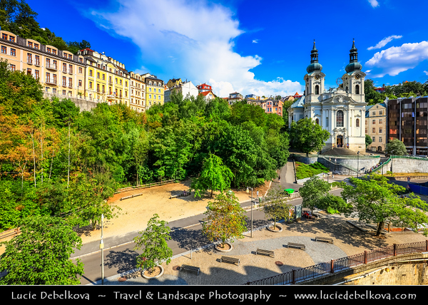Europe - Czech Republic - Czechia - Karlovy Vary - Carlsbad - Karlsbad - Spa town on confluence of rivers Ohře & Teplá, named after Charles IV, Holy Roman Emperor & King of Bohemia, who founded city in 1370 - Historically famous for its hot springs (13 main springs, about 300 smaller springs) - Historic part of Karlovy Vary with twin-steeple Catholic Church of St. Mary Magdalene - Kostel Mari Magdaleny
