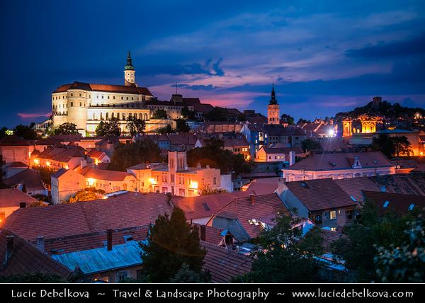 Europe - Czech Republic - Czechia - Jižní Morava - South Moravia - Mikulov - Historical town with Mikulov Castle, Baroque chateau built atop rock dominanting Mikulov skyline for centuries - Twilight - Blue Hour - Night