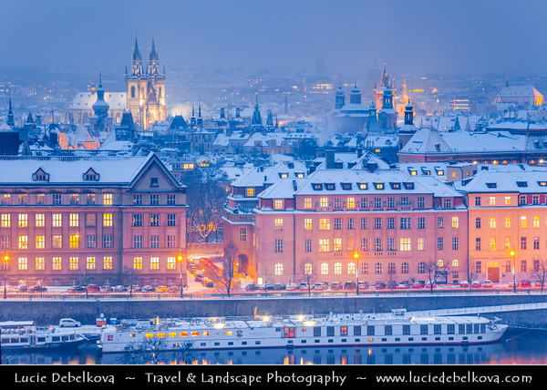 Europe - Czech Republic - Bohemia - Prague - Praha - Historical Centre - Prague Old Town - Staré Město Pražské - UNESCO World Heritage Site - Cityscape along river Vltava - Moldau  under fresh snow during winter at Dusk - Blue Hour - Twilight - Night