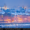 Europe - Czech Republic - Bohemia - Prague - Praha - Historical Centre - Prague Old Town - Staré Město Pražské - UNESCO World Heritage Site - Cityscape along river Vltava - Moldau  under fresh snow during winter at Dusk - Blue Hour - Twilight - Night