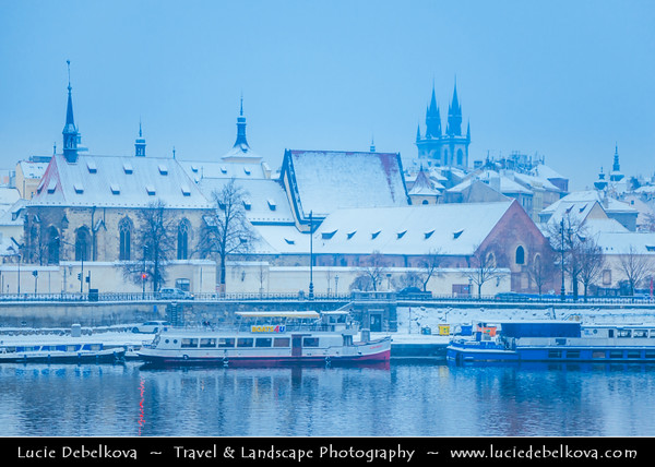 Europe - Czech Republic - Bohemia - Prague - Praha - Historical Centre - Prague Old Town - Staré Město Pražské - UNESCO World Heritage Site - City Skyline along banks of Vltava River during winter under fresh cover of snow