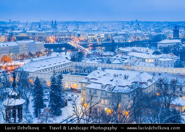 Europe - Czech Republic - Bohemia - Prague - Praha - Historical Centre - Prague Old Town - Staré Město Pražské - UNESCO World Heritage Site - Roofs of Historical City Center under fresh snow during winter at Dusk - Blue Hour - Twilight - Night