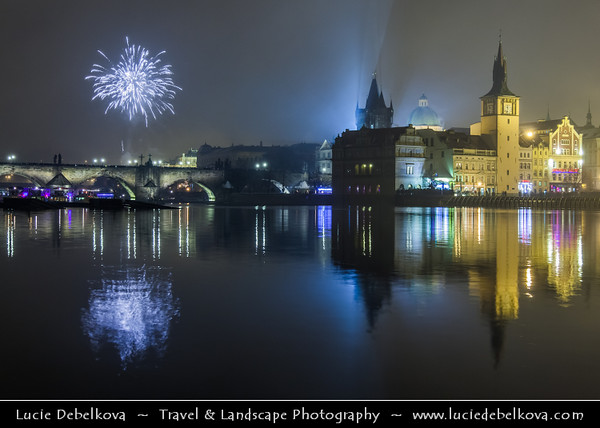 Europe - Czech Republic - Bohemia - Prague - Praha - Historical Centre - Prague Old Town - Staré Město Pražské - UNESCO World Heritage Site - Charles bridges - Karlův Most - One of the most iconic Prague locations over Vltava River & Lavka Towers at night during New Year's Firework display
