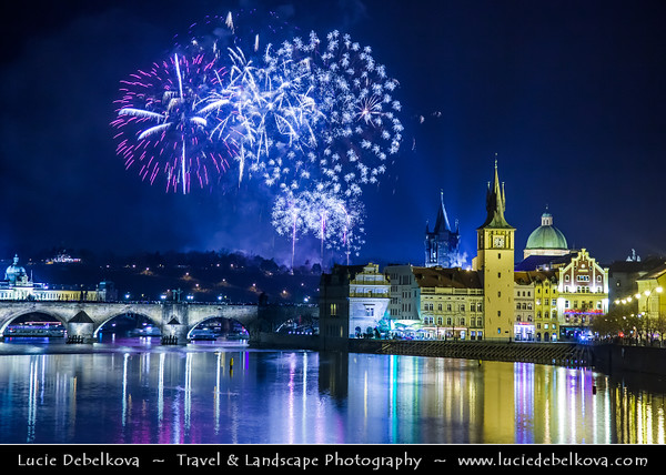 Europe - Czech Republic - Bohemia - Prague - Praha - Historical Centre - Prague Old Town - Staré Město Pražské - UNESCO World Heritage Site - Charles bridges - Karlův Most - One of the most iconic Prague locations over Vltava River & Lavka Towers - New Year's Firework display