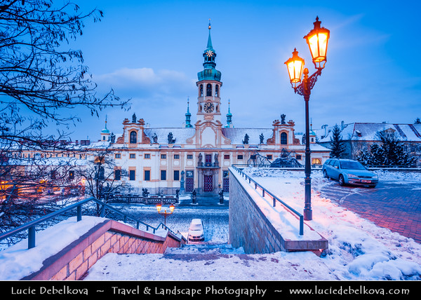 Europe - Czech Republic - Bohemia - Prague - Praha - Historical Centre - Prague Old Town - Staré Město Pražské - UNESCO World Heritage Site - Loreta - Baroque historic monument, cloister, clock tower with a famous chime and place of pilgrimage during winter under fresh cover of snow