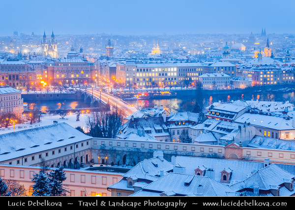 Europe - Czech Republic - Bohemia - Prague - Praha - Historical Centre - Prague Old Town - Staré Město Pražské - UNESCO World Heritage Site - Roofs of Historical City Center under fresh snow during winter at Dusk - Blue Hour - Twilight - Night