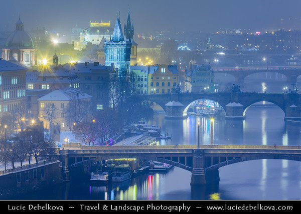Europe - Czech Republic - Bohemia - Prague - Praha - Historical Centre - Prague Old Town - Staré Město Pražské - UNESCO World Heritage Site - Bridges over the Vltava river under fresh snow during winter twilight - dusk - blue hour - night