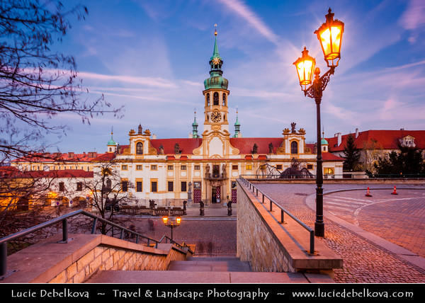 Europe - Czech Republic - Bohemia - Prague - Praha - Historical Centre - Prague Old Town - Staré Město Pražské - UNESCO World Heritage Site - Loreta - Baroque historic monument, cloister, clock tower with a famous chime and place of pilgrimage at Dusk - Twilight - Blue Hour - Night