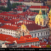 Czech Republic - Prague - Praha - Capital City - Sunset over Historical Center with many old red roof houses with St. Nicholas / Svaty Mikulas at Church Lesser Town Square / Malostranske Namesti