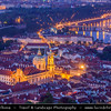 Czech Republic - Prague - Praha - Capital City - Dusk over Historical Center with many old red roof houses with St. Nicholas / Svaty Mikulas at Church Lesser Town Square / Malostranske Namesti