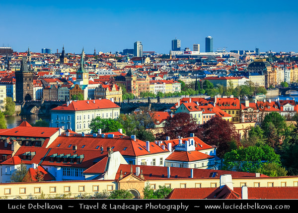 Europe - Czech Republic - Czechia - Bohemia - Čechy - Prague - Praha - Historical Centre - Prague Old Town - Staré Město Pražské - UNESCO World Heritage Site - Iconic cityscape with church towers and typical red roofs alond Vltava river