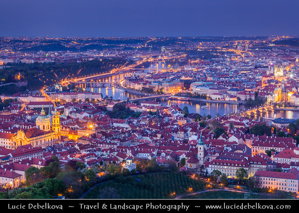 Czech Republic - Prague - Praha - Capital City - Dusk over Historical City Center with many old red roof houses and Vltava River