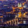 Czech Republic - Prague - Praha - Capital City - Dusk over Historical City Center with many old red roof houses, Charles Bridge / Karluv Most and Vltava River