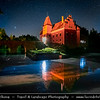 Europe - Czech Republic - Czechia - South Bohemian Region - Červená Lhota Vodní Zámek - Red Lhota Water Château - Iconic red castle standing at middle of lake on rocky island - Night sky with stars