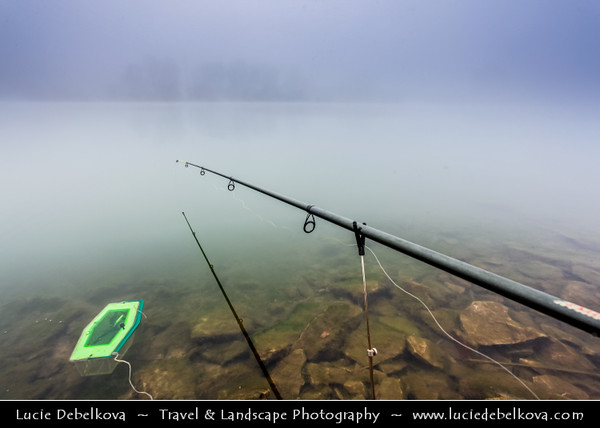 Europe - Czech Republic - Central Bohemian Region - Čelákovice - Malvíny - Lake in former sand quarry during misty day - Fishing in the mist