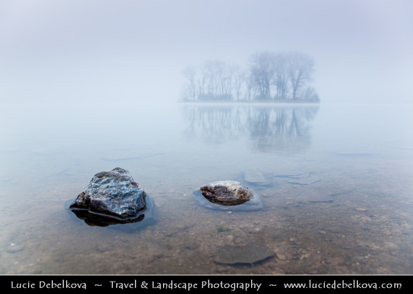 Europe - Czech Republic - Central Bohemian Region - Čelákovice - Malvíny - Lake in former sand quarry during misty day