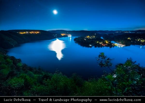 Europe - Czech Republic - Czechia - Bohemia - Čechy - Slapy Water Reservoir - Part of Vltava Cascade water management system - Night sky with stars & Setting Full Moon