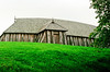 "The reconstructed longhouse at Fyrkat is 28.40 meters (93+ feet) long, 7.40 meters (24+ feet) wide and 7.50 meters (almost 25 feet) high. The 210 square-meter (2260.4 square feet) house is divided into one 16 meter-long (52.5 feet) living room and two smaller rooms probably used for (weapons?) storage and food preparation.<br /> <br /> Construction began in May, 1982 and was completed in December, 1984. It took 24,192 man hours, which corresponds 50 men working two and a half years.<br /> <br /> I can hear the roar of a feast from the pages of Beowulf coming from within.<br /> <br /> You can see more details here, but the text is in Danish: <a href=""http://www.fyrkat.dk/vcf/Huset.html"">http://www.fyrkat.dk/vcf/Huset.html</a> and BTW Google Translate is not much better than I am."